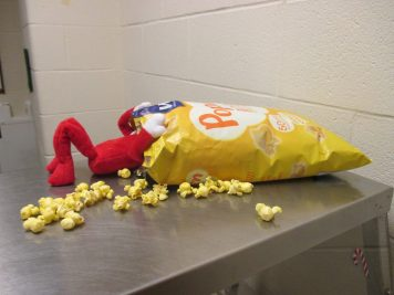 This Jefferson Elementary School (IN) stuffs his face with popcorn, showing students how not to eat lunch!
