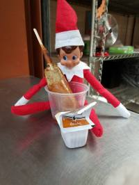 The elf in Yuma Elementary School in Arizona joins in on the school meal fun!
