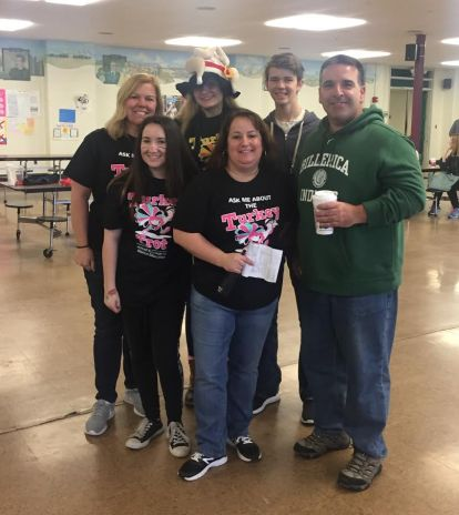 Volunteering for the annual Billerica 5k Turkey Trot is one way April goes above and beyond. Pictured are volunteers - Front Row: Emilee Laske, 9th grade; April; Mark Efstratiou, School Committee; Back Row: Cheryl Green, Nutrition Operations Manager; Victoria Bones, 11th grade; Nolan Rexford, 9th grade.