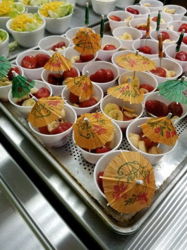 Hawaiian cocktail style cups served as the fruit cups for the day.