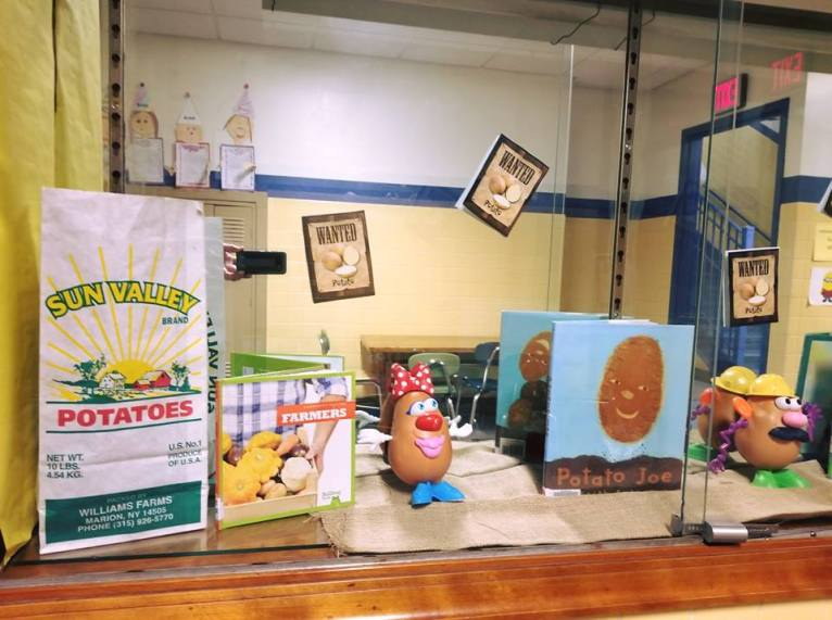 A cafeteria display highlights the Wayne Wednesday (NY) local produce of the month, potatoes, in a fun and colorful way.
