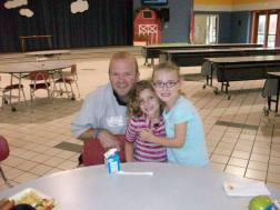 A father poses with his two daughters at Trace Crossings Elementary School's (AL) Take Your Parent To Lunch Day.