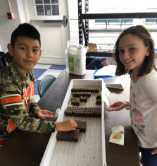 Planting new pepper seeds for their hydroponic garden.