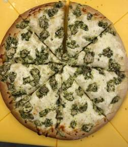 Homemade chicken pesto pizza.